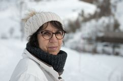 Mature woman with  winter cap in the mountain. Mature woman with a winter cap in the mountain Royalty Free Stock Photography
