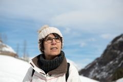 Mature woman with  winter cap in the mountain. Mature woman with a winter cap in the mountain Stock Image