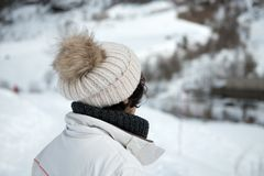 Mature woman with  winter cap in the mountain. Mature woman with a winter cap in the mountain Royalty Free Stock Images