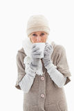 Mature woman in winter clothes holding mug Stock Photography