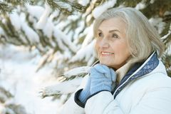 Mature woman clothes posing outdoors Royalty Free Stock Image