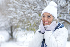 Mature woman in winter clothes Stock Images