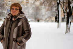 Mature woman in winter clothes Royalty Free Stock Photography