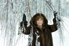 Mature woman in a winter forest Stock Photography