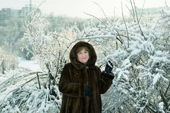 Mature woman in a winter forest Stock Photos
