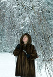 Mature woman in a winter forest Royalty Free Stock Photo
