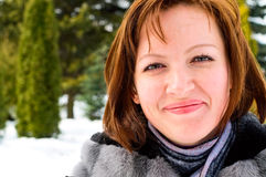 Mature woman in winter park Royalty Free Stock Image