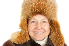 Mature woman in wintry clothes. Portrait of elegant senior lady in fur coat and fur cap stock photography