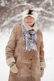 Mature woman in wintry forest Stock Photo