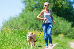 Mature Woman With Dog Taking Hiking In The Country Royalty Free Stock Image