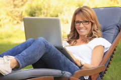 A mature woman working at home Royalty Free Stock Image