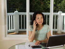 Mature woman working from home office Stock Photography