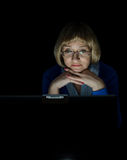 Mature woman working on laptop. Computer in night Royalty Free Stock Photography