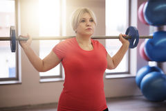 Mature woman working out at the gym Stock Images