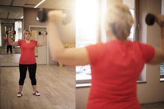 Mature woman working out at the gym Stock Image