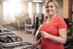 Mature woman working out at the gym Stock Photos