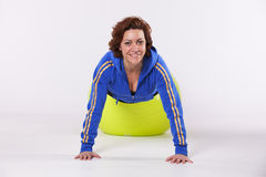 Mature woman working out Royalty Free Stock Images
