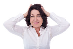 Mature woman worried about something isolated on white Stock Image