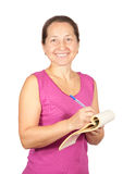 Mature woman writing on notebook Stock Images