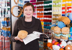 Mature woman in yarn shop Royalty Free Stock Photo