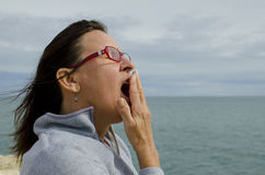 Mature Woman Yawning Royalty Free Stock Images