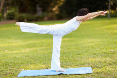Mature woman yoga. Mid age mature woman doing yoga outdoors Stock Images