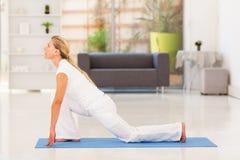 Mature woman yoga. Mature woman doing yoga at home Royalty Free Stock Photo