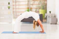 Mature woman yoga. Mature woman doing yoga at home Royalty Free Stock Photography
