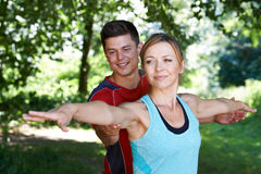 Mature Woman With Yoga Coach In Park. Mature Woman With Yoga Coach Royalty Free Stock Images