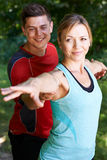 Mature Woman With Yoga Coach In Park Stock Images