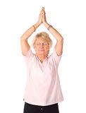 Mature woman in yoga position Stock Photography