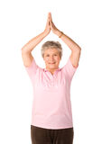 Mature woman in yoga position. Mature older lady in yoga position, isolated on white background stock photos