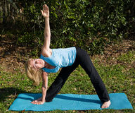 Mature Woman Yoga - Triangle Pose Stock Photo