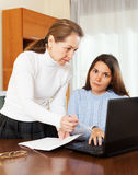 Mature woman and yong daughter with notebook Stock Photos