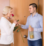 Mature woman and young guy at doorway Royalty Free Stock Images