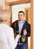 Mature woman and young guy at doorway Stock Photography