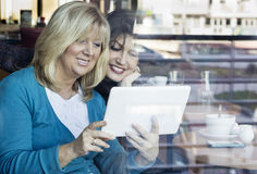 Mature women with digital tablet Royalty Free Stock Images