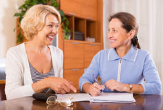 Mature women with documents Stock Image