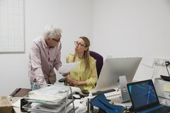Colleagues Having a discussion in the Office royalty free stock photos