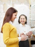Woman helps the girl in choosing bridal accessories Royalty Free Stock Photo