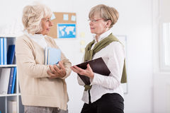 Mature women from learning group. Image of mature women from learnig group in library Stock Photography