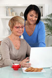 Mature women with a notebook Stock Photography