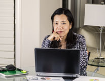 Mature women relaxed while working at Home Stock Photos