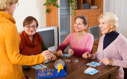 Mature women with table game Stock Photos
