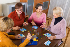 Mature women with table game Royalty Free Stock Photos