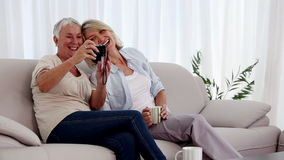 Mature women taking a picture together stock video