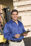 Mature Worker Holding Clipboard Stock Image