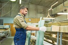Mature Worker at Modern Furniture Factory stock image