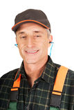 Mature worker wearing ear protectors Stock Image