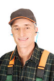 Mature worker wearing ear protectors Royalty Free Stock Photography